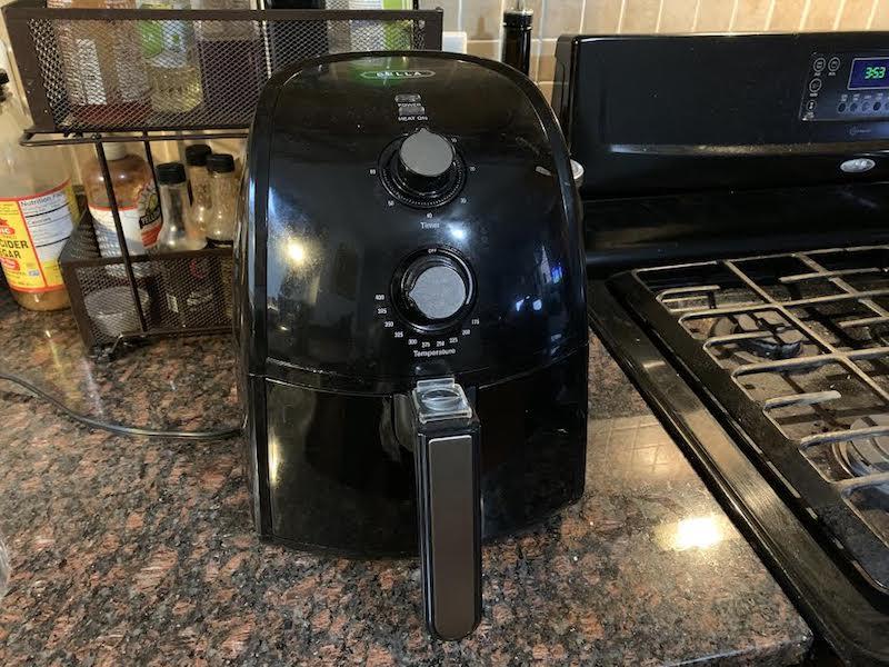 black air fryer on kitchen counter