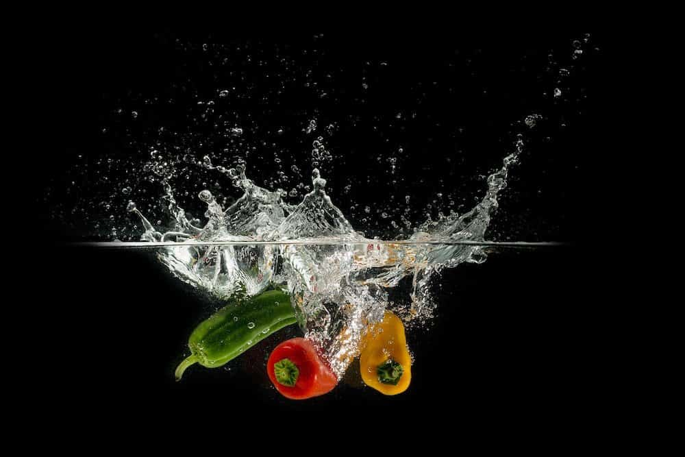 bell peppers falling in water